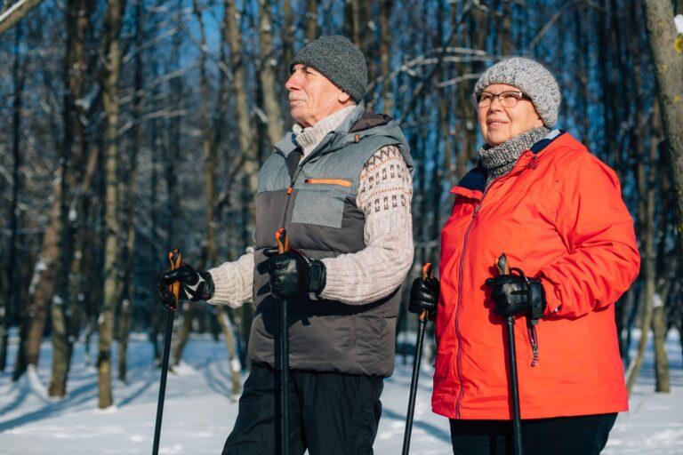 Active senior couple walking with poles